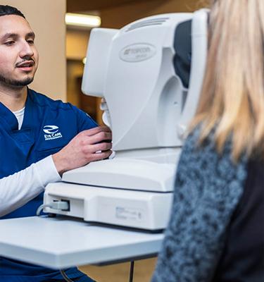 Eye Tech gives patient an eye exam